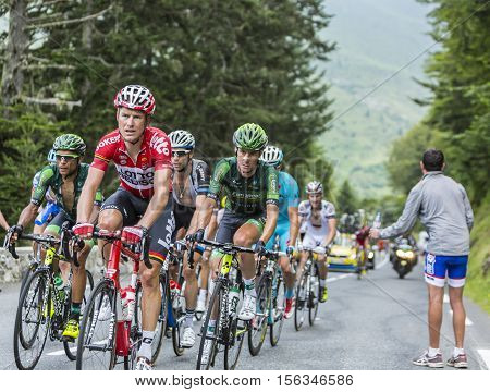 Col du Tourmalet France - July 242014: The peloton climbing the road to Col de Tourmalet in the stage 18 of Le Tour de France 2014.