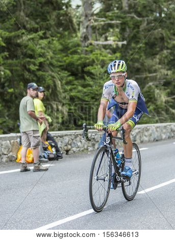 Col du Tourmalet France - July 242014: The Canadian cyclist Christian Meier of Orica-GreenEDGE Team climbing the difficult road to Col du Tourmalet in Pyrenees Mountains during the stage 18 of Le Tour de France 2014.