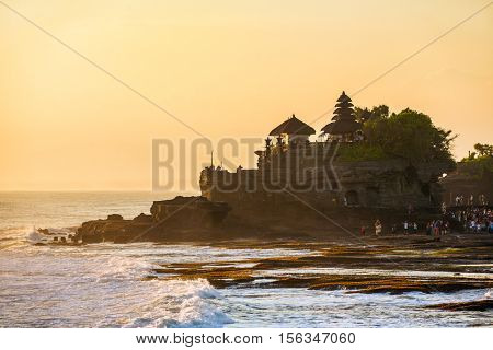 Tanah Lot temple and sea waves in beautiful sunset light, Bali, Indonesia