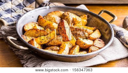 Potato. Roasted potatoes. American potatoes with salt pepper and cumin. Roasted potato wedges delicious crispy.
