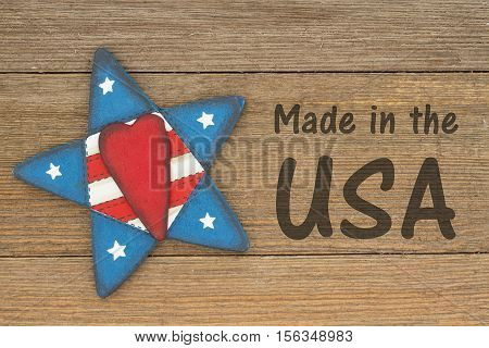 Made in the USA message USA patriotic old flag star and weathered wood background with text Made in the USA