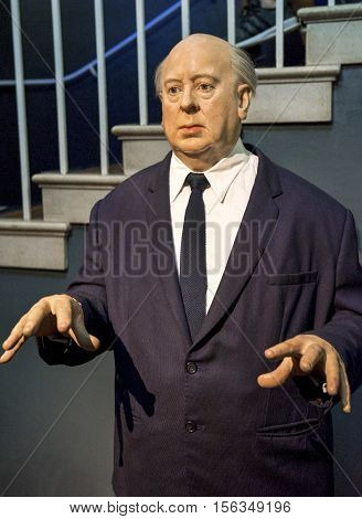 London, the UK-May 2016: Alfred Hitchcock wax figure in Madame Tussaud's  museum
