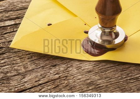 seal stamper, wax and brown envelope