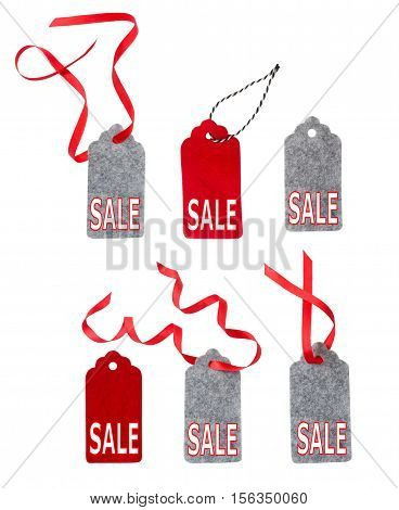 Set of color gift tags isolated on white background. Christmas gift tag tied with red ribbon. Label from gray and red felt.