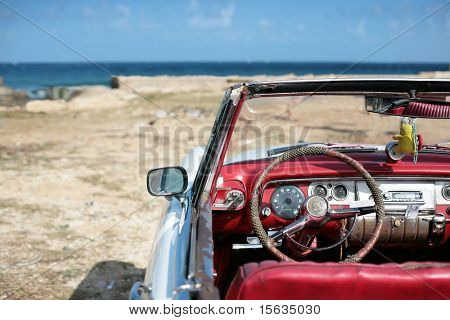 cuban vintage car parked on the seacost in havana