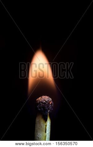 Burning match isolated on a black background macro image