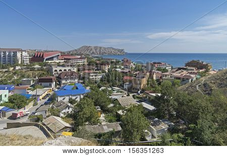 The coastal part of the resort town of Sudak in Crimea. September sunny day.