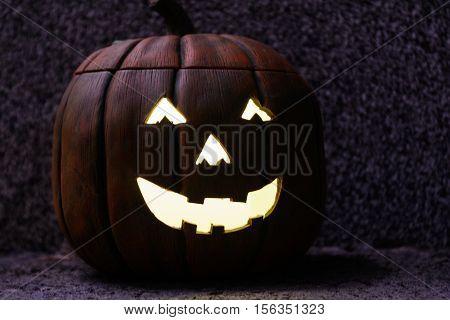 Decorative Halloween pumpkin with creepy lighting - close-up