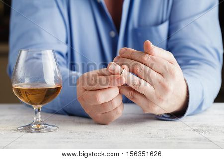Divorce Concept. Man Taking Off Wedding Ring