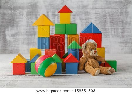 Toy Blocks City, Baby House Building Bricks, Kids Wooden Cubic Over White Background