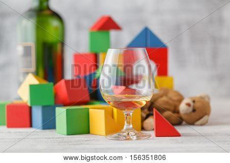 Alcoholism Issue. Broken Toy Blocks City, Baby House Building Bricks, Kids Wooden Cubic Over White B