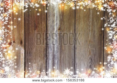 Christmas background with lights bokeh stars and snow. Paints holiday. Old Wooden background in rustic style. Retro. New Year.