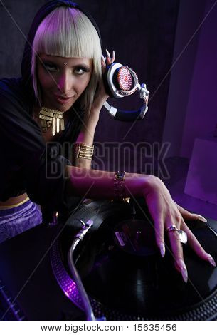 beautiful girl dj playong on vinyl player