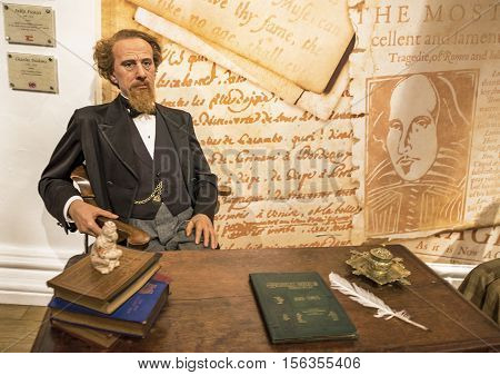 London, the UK - May 2016:  Charles Dickens wax figure in Madame Tussaud museum