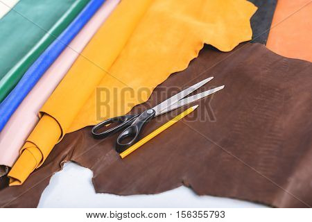 color samples of a leather on a table with scissors