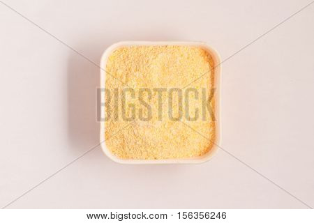 Corn Couscous into a bowl isolated on white background. Cuscus