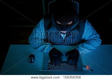 man in mask with laptop,  information security