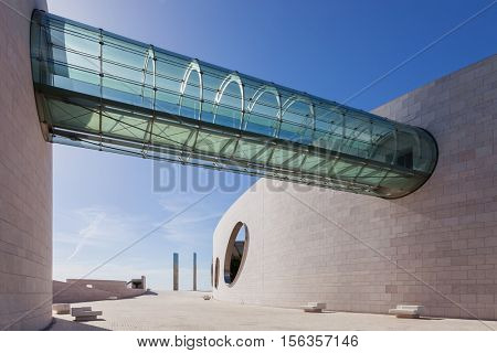 Lisbon, Portugal - October 31, 2016:  Glass Tunnel Bridge between the building wings in the Champalimaud Foundation, Centre for the Unknown. Biomedical private research center.