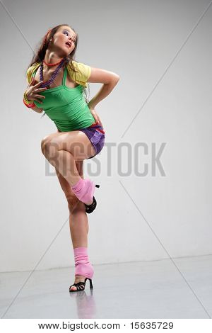cool looking and stylishly dressed dancer posing