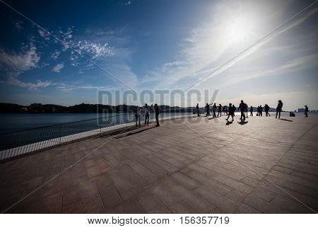 Lisbon, Portugal - October 31, 2016: Sunset on the rooftop of the MAAT - Museum of Art, Architecture and Technology. Open since October 5th. Designed by the British architect Amanda Levete
