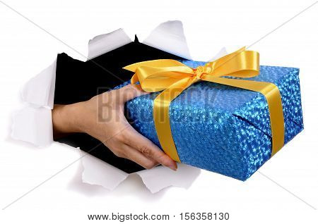 Man Hand Delivering Or Giving Gift Through Torn White Paper Background
