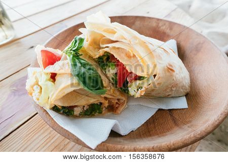 Vegetarian Roll On A Wooden Plate, Healthy Food, Vegetarian Food Ayurveda. Film Effect And Shallow F