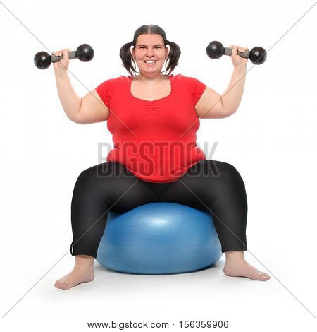 Overweight woman training and slimming with weights after lavish eating during the christmas holidays. Body care and healthy lifestyle theme. Active people isolated on white background.
