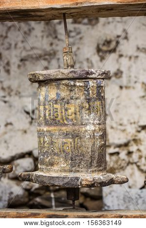 Manang, Nepal - May 6, 2016: Buddhist prayer mani wall with prayer wheels in nepalese village on the Annapurna circuit trekking route, Nepal