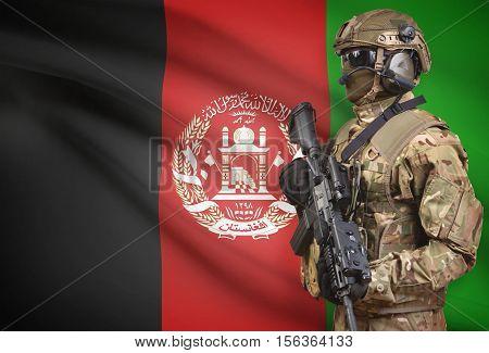 Soldier In Helmet Holding Machine Gun With Flag On Background Series - Afghanistan