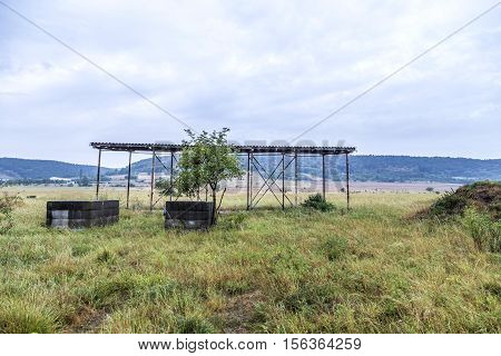 old rotten baracks and military buildings in a meadow in former East Germany poster