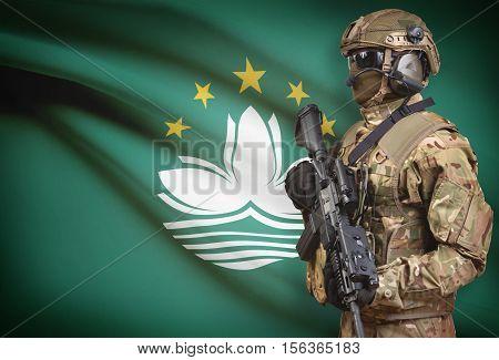 Soldier In Helmet Holding Machine Gun With Flag On Background Series - Macau