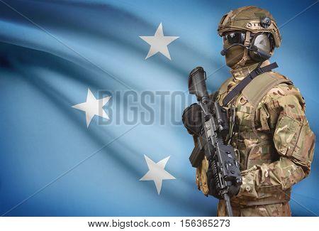 Soldier In Helmet Holding Machine Gun With Flag On Background Series - Micronesia