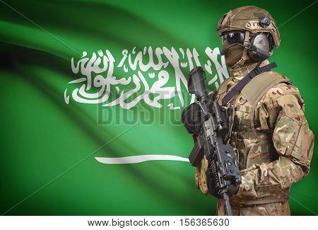 Soldier In Helmet Holding Machine Gun With Flag On Background Series - Saudi Arabia