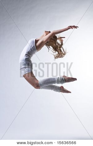 modern ballet dancer posing on white background