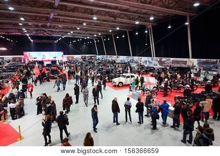 MOSCOW - MAR 07, 2016: Many people look at retro cars on exhibition Oldtimer-Gallery in Sokolniki Exhibition Center. It is only one in Russia exhibition of vintage cars and technical antiques