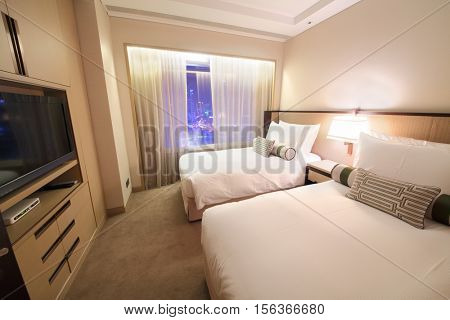 SHANGHAI - NOV 05, 2015: Empty modern bedroom with tv in apartments of IFC Residence hotel