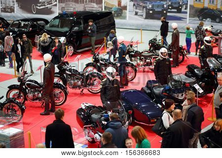 MOSCOW - MAR 07, 2016: Retro bikes and cars on exhibition Oldtimer-Gallery in Sokolniki Exhibition Center. It is only one in Russia exhibition of vintage cars and technical antiques