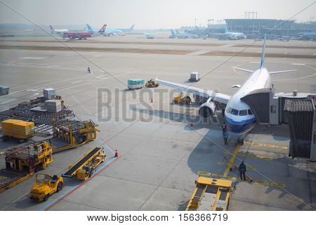 SEOUL - NOV 05, 2015: Several planes on runway and terminals of Incheon airport is largest aviation hub of country