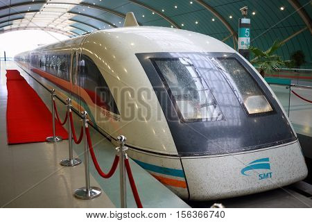 SHANGHAI - NOV 05, 2015: Shanghai Transrapid SMT maglev train are on station, maglev is train, held over roadbed, driven and controlled by power of electromagnetic field