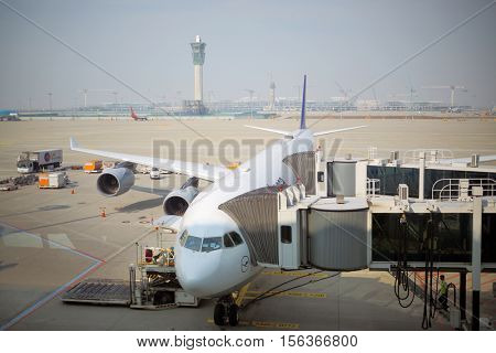 SEOUL - NOV 05, 2015: Plane at terminal of Incheon airport is largest aviation hub of country