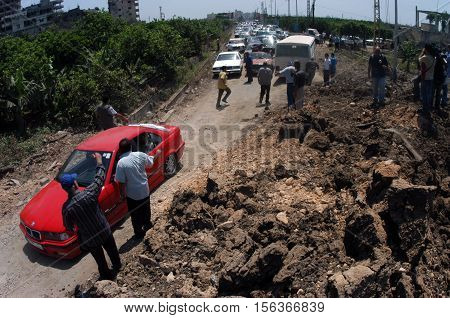 TYRE,LEBANON-JULY 31: Unidentified Civilians fleeing the Israeli bombardment on July 31, 2006 in Tyre,Lebanon.