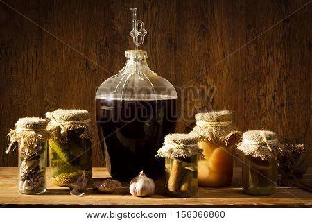 Homemade Wine In Larder With Vegetables Jars