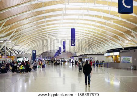 SHANGHAI, CHINA - NOV 8, 2015: People with luggage in airport, Shanghai airport is equipped with 28 bridge crossings and 127 parking areas
