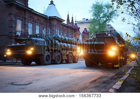 SAMARA, RUSSIA - MAY 6, 2015: Rows of trucks with rocket launchers on streets of Samara at dusk on military celebration. President satisfied with Victory Day,