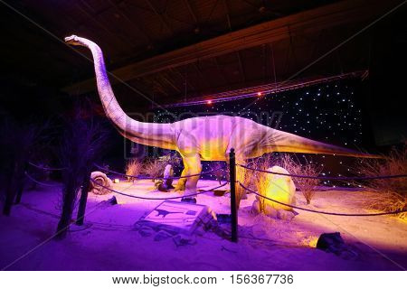 MOSCOW - JAN 30, 2015: Diplodocus dinosaur at show of dinosaurs in pavillion of VDNKH, text translation - omeyzavr yungans