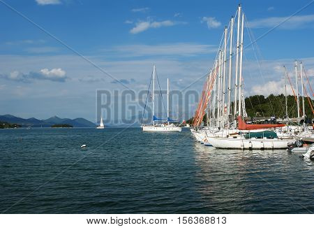 Nidri GREECE May 11 2013: Landscape with blue harbour green coast mountains and yachts in Ionian sea Greece.
