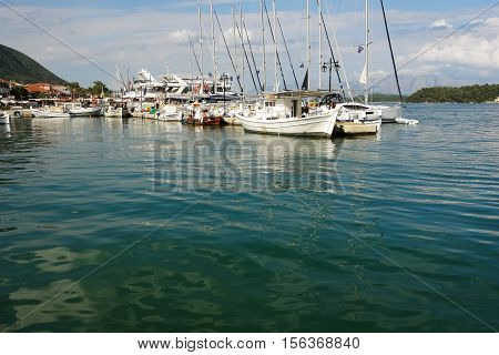 Nidri GREECE May 11 2013: Landscape with blue harbour green coast big fishing-boat and yachts in Ionian sea Greece.