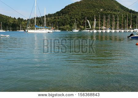 Nidri GREECE May 11 2013: Landscape with blue harbour green coast and yachts in Ionian sea Greece.