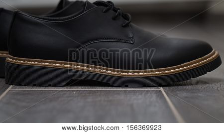 Classic stylish men's shoes closeup on gray background