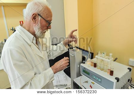Saint-Petersburg Russia - July 8 2013: National Centre for the control and quality of goods and services. Chemical laboratory for testing food. Chemist laboratory produces edible oil analysis